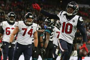 Houston Texans wide receiver DeAndre Hopkins (10) celebrates his 1-yard touchdown reception against the Jacksonville Jaguars during the fourth quarter of an NFL football game at Wembley Stadium on Sunday, Nov. 3, 2019, in London.