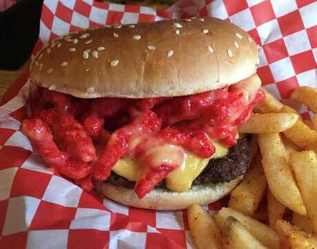 The Chamuco Burger at Monster Burgers has nacho cheese and hot Cheetos.