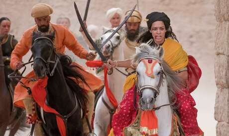 """Devika Bhise, right, plays the title character in """"The Warrior Queen of Jhansi,"""" which she also co-wrote. MUST CREDIT: Handout photo by Nick Wall/Roadside Attractions"""