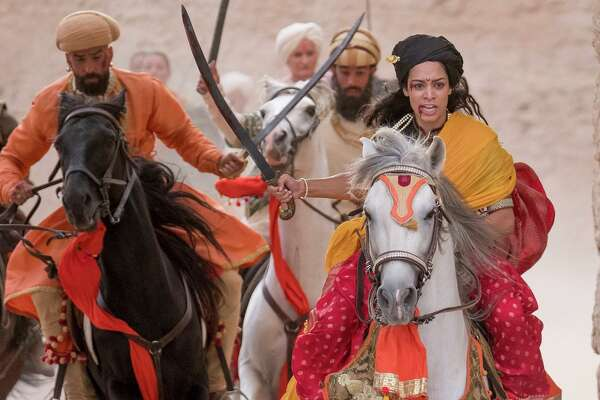 "Devika Bhise, right, plays the title character in ""The Warrior Queen of Jhansi,"" which she also co-wrote. MUST CREDIT: Handout photo by Nick Wall/Roadside Attractions"