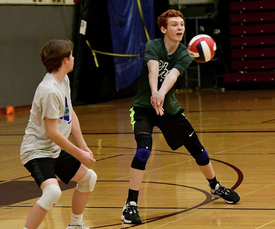 Shenendhowa volleyball player Tyler Christensen, right, returns the ball during a scrimmage against Burnt Hills on Tuesday, Nov. 12, 2019 in Burnt Hills, N.Y. (Lori Van Buren/Times Union) Photo: Lori Van Buren, Albany Times Union / 40048240A