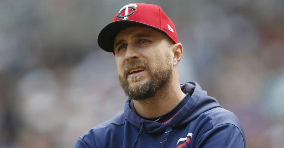 FILE - In this May 11, 2019, file photo, Minnesota Twins manager Rocco Baldelli looks up during the team's baseball game against the Detroit Tigers in Minneapolis. Baldelli has narrowly beaten out Aaron Boone of the New York Yankees to win AL Manager of the Year. (AP Photo/Jim Mone, File) Photo: Jim Mone/Associated Press