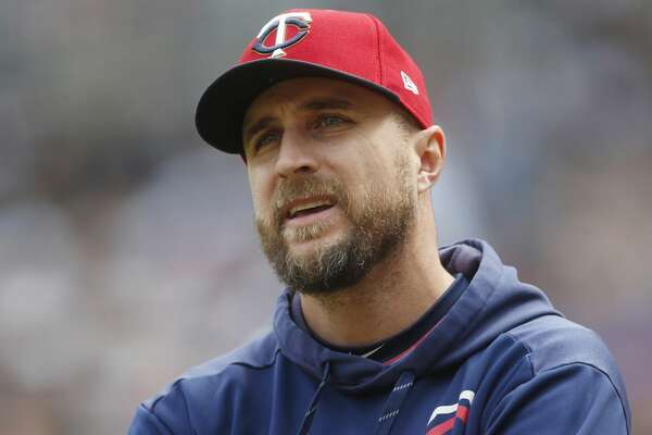 FILE - In this May 11, 2019, file photo, Minnesota Twins manager Rocco Baldelli looks up during the team's baseball game against the Detroit Tigers in Minneapolis. Baldelli has narrowly beaten out Aaron Boone of the New York Yankees to win AL Manager of the Year. (AP Photo/Jim Mone, File)