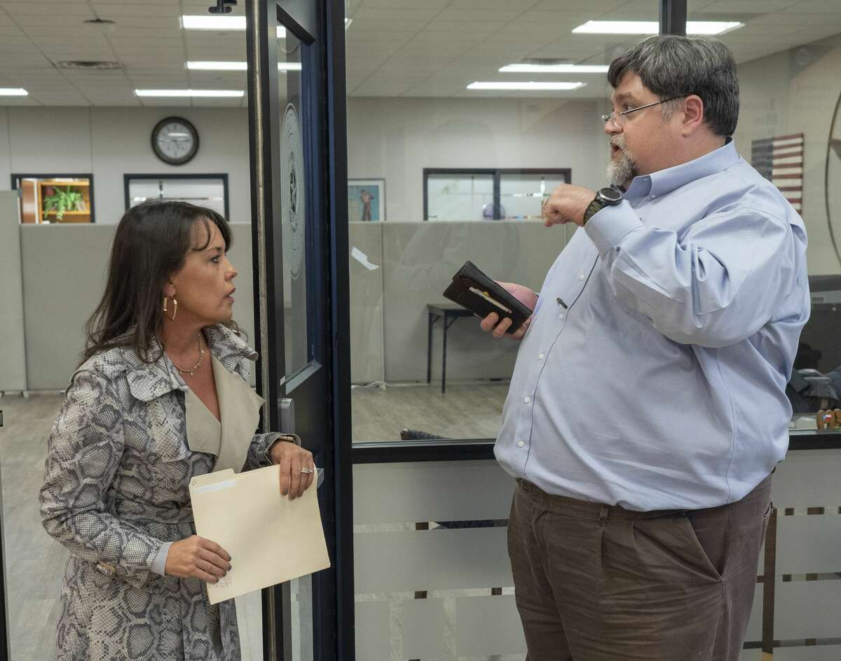 Kenye Kay Butts talks to Brandon Hodges 11/12/19 evening outside the elections office after a final count of ballots reveal the MISD Bond did not pass. Tim Fischer/Reporter-Telegram