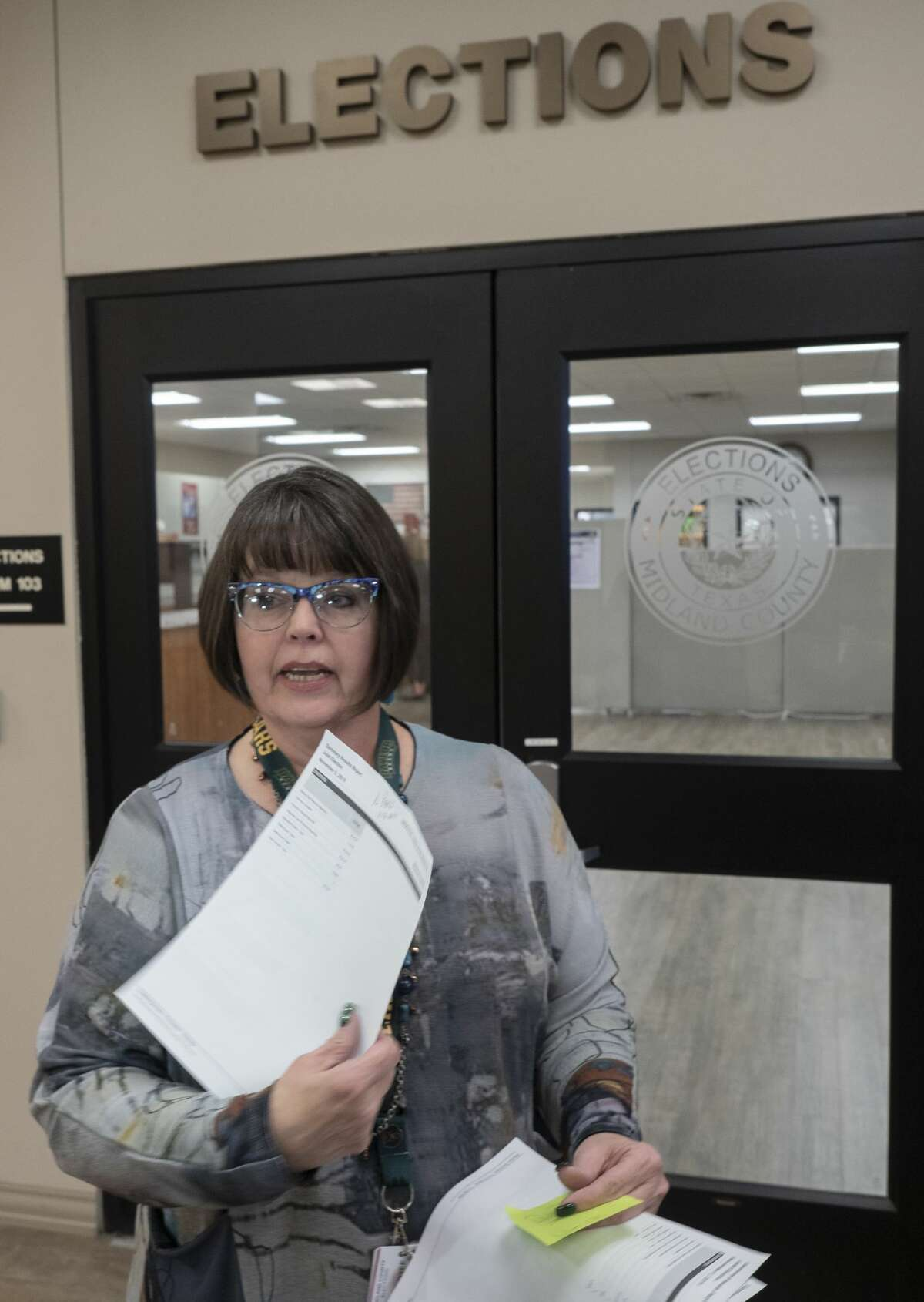 Deborah Land, Midland County Elections Administrator, gives the final vote tally for the MISD Bond 11/12/19 evening outside the elections office. Tim Fischer/Reporter-Telegram