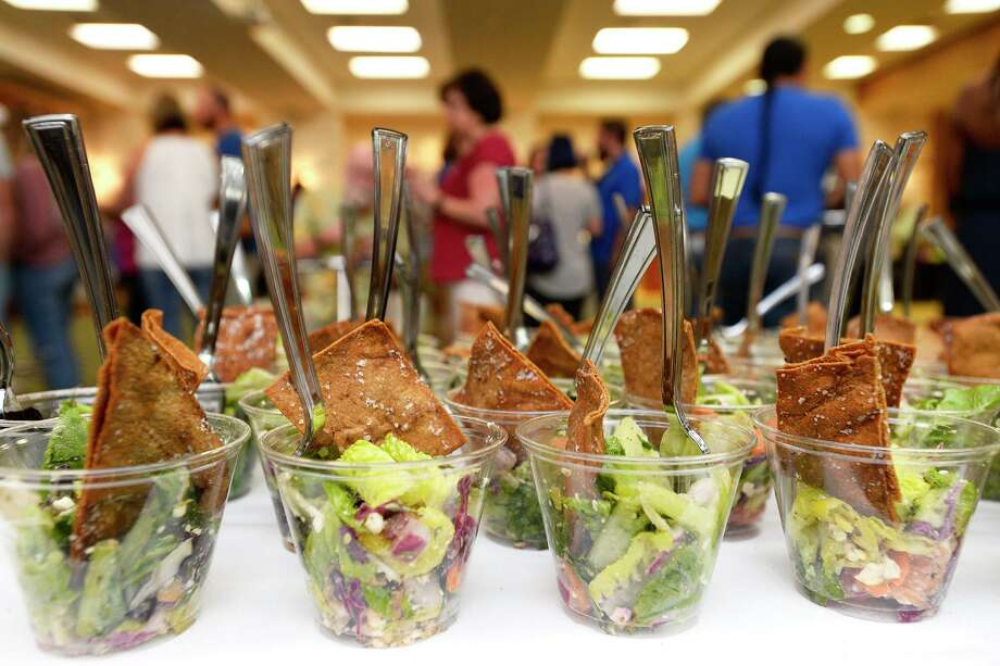 Cups of Greek salad sit out for guests to try at the Salata booth during the #EatBMT Restaurant Week preview event at Del Papa Distributing.   Photo taken Thursday 8/23/18  Ryan Pelham/The Enterprise Photo: Ryan Pelham / The Enterprise / ©2018 The Beaumont Enterprise