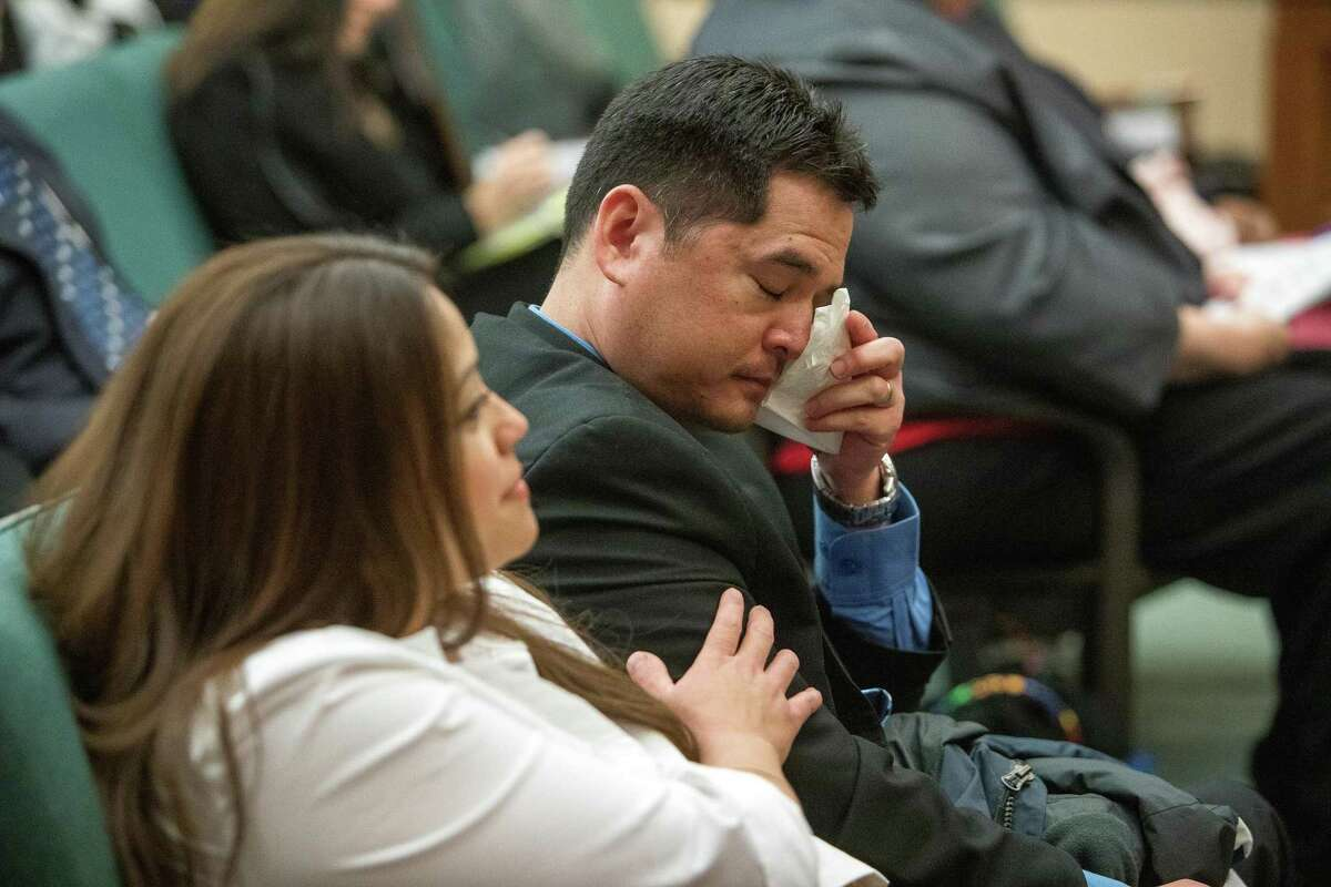 Jason Troy, right, dries tears before the start of testimony during a the Texas House of Representatives Human Services Committee hearing at the capitol in Austin, Texas on November 12, 2019. Troy's sons were removed by Child Protective Services after mistaking a neurological condition for child abuse in 2015. Troy lost his job after being accused of felony child abuse which was later dropped by CPS.