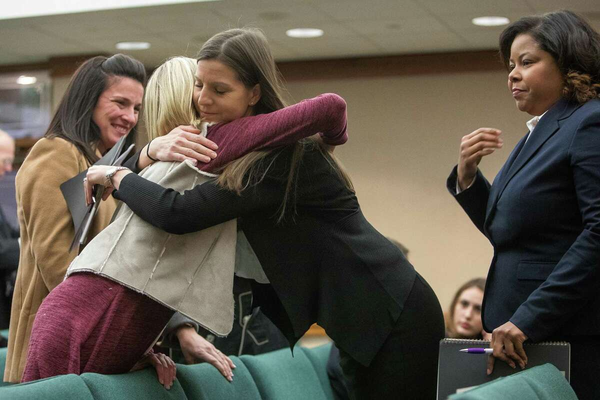 Ann Marie Timmerman, right, embraces, Emily Neild, left before the start of testimony during a the Texas House of Representatives Human Services Committee hearing at the capitol in Austin, Texas on November 12, 2019. Timmerman's son was removed by Child Protective Services after being misdiagnosed during an emergency room visit in May 2016. Neild, 13, suffers from a mitochondrial disease and has been reported to CPS twice by doctors who had little knowledge of her condition.