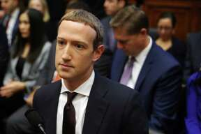 Facebook co-founder and CEO Mark Zuckerberg arrives to testify before the House Financial Services Committee in the Rayburn House Office Building on Capitol Hill October 23, 2019 in Washington, DC. (Chip Somodevilla/Getty Images/TNS)