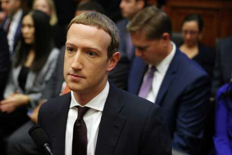 Facebook co-founder and CEO Mark Zuckerberg arrives to testify before the House Financial Services Committee in the Rayburn House Office Building on Capitol Hill October 23, 2019 in Washington, DC.