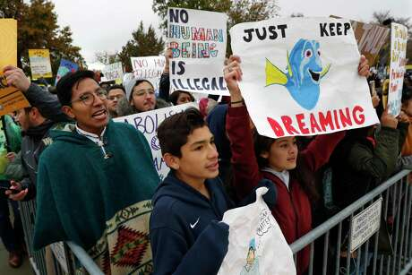 Supporters of DACA including David Castro, 14, center, and Anahi Andino, 17, right, both of Baltimore, rally outside the Supreme Court as oral arguments are heard in the case of President Trump's decision to end the Obama-era, Deferred Action for Childhood Arrivals program (DACA), Tuesday, Nov. 12, 2019, in Washington.