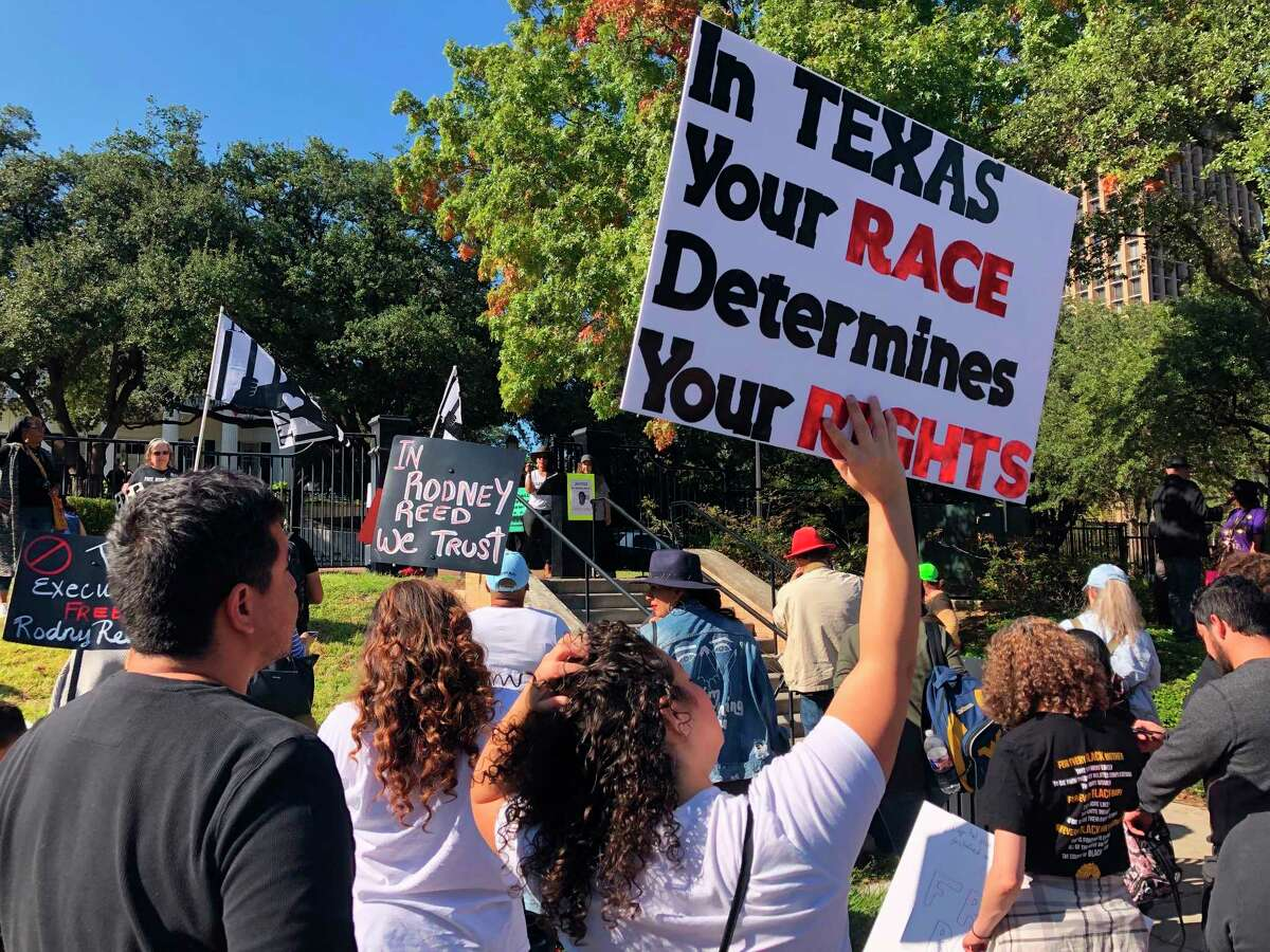 Supporters rally to stop the execution of Texas death row inmate Rodney Reed outside the governor's mansion on Saturday, Nov. 9, 2019. In his five years as Texas' governor, Republican Greg Abbott has overseen the execution of nearly 50 prisoners while only once sparing a condemned man's life, after a victims' family asked him to do so.