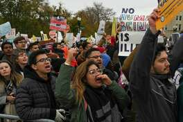 Arlin Karina Tellez, a Deferred Action for Childhood Arrivals recipient and student at Trinity Washington University, is among the demonstrators gathered in front of the United States Supreme Court, where the justices hear arguments on a DACA case Tuesday, Nov. 12, 2019, in Washington.