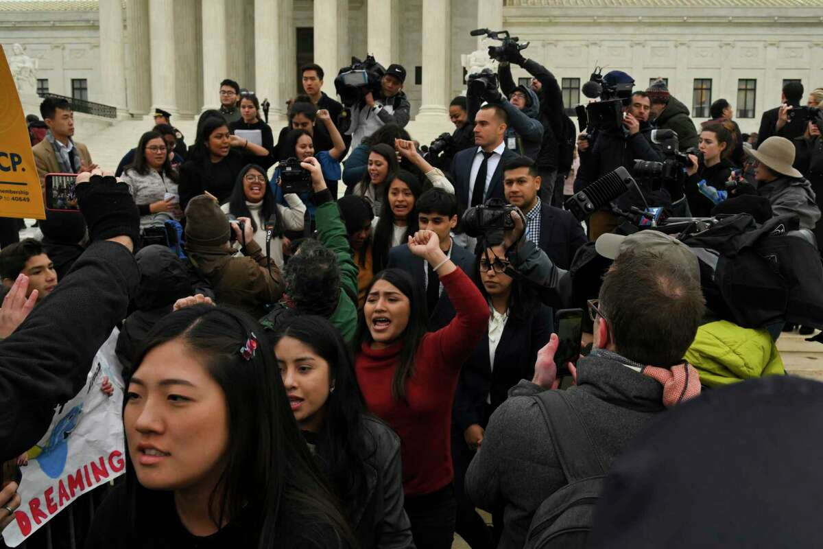 Deferred Action for Childhood Arrivals plaintiffs leave the United States Supreme Court, where the justices hear arguments on a DACA case Tuesday, Nov. 12, 2019, in Washington.