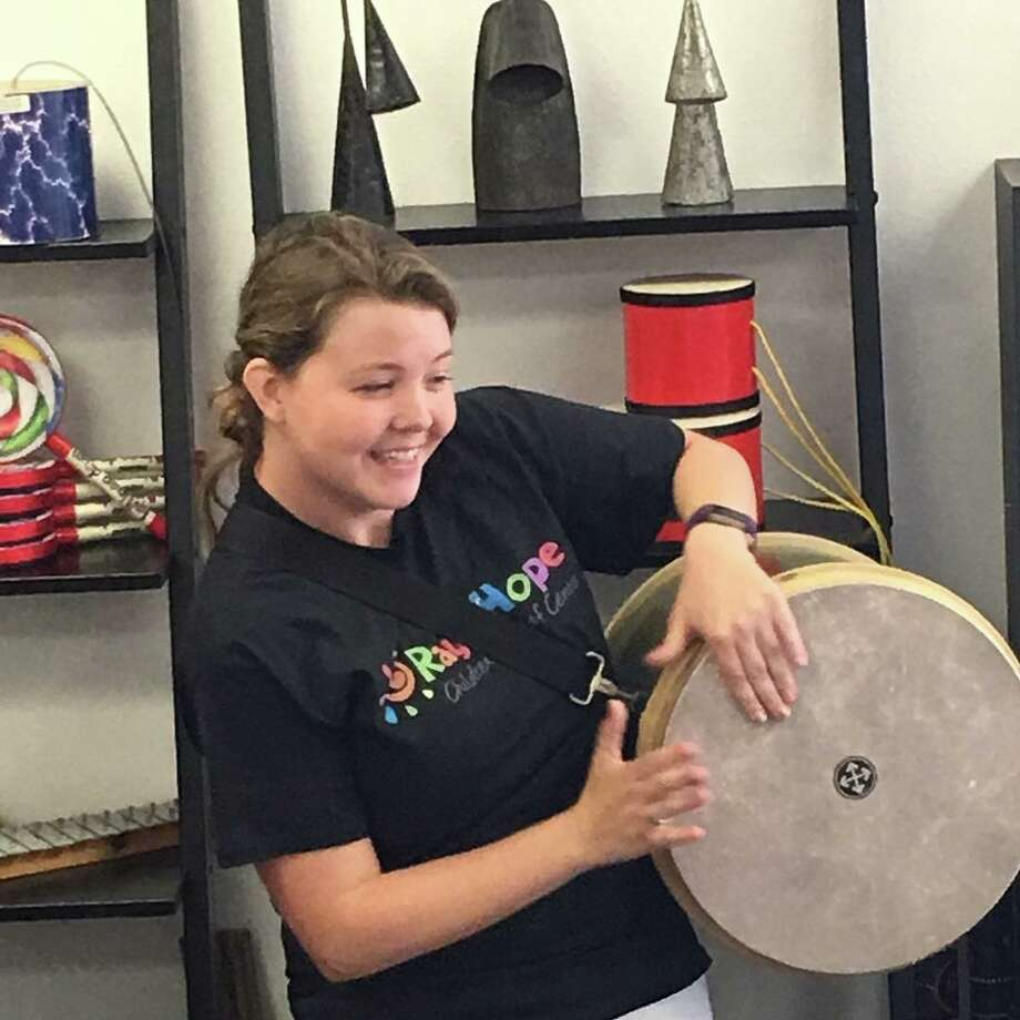 Music therapist Stephanie Seton works with kids at Rays of Hope Children's Grief Centre. Photo: Courtesy Photo