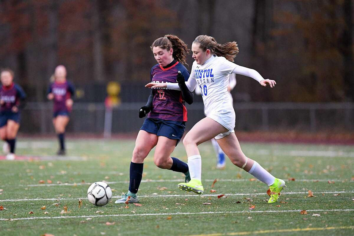 Foran's Colleen Ardolino and Bristol Eastern's Kate Kozlowski battle for possession during a Class L first-round match on Tuesday.