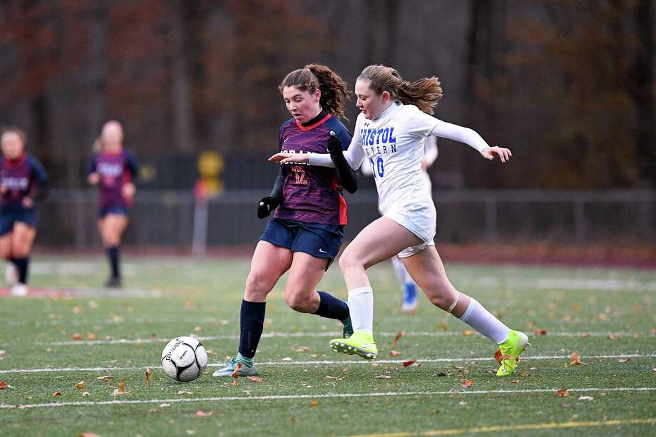 Foran's Colleen Ardolino and Bristol Eastern's Kate Kozlowski battle for possession during a Class L first-round match on Tuesday. Photo: David G. Whitham / For Hearst Connecticut Media / Stamford Advocate Freelance