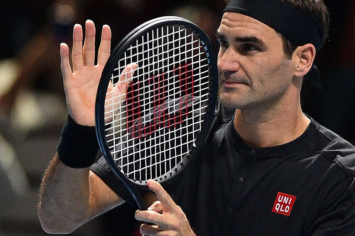 Switzerland's Roger Federer celebrates winning against Italy's Matteo Berrettini during their men's singles round-robin match on day three of the ATP World Tour Finals tennis tournament at the O2 Arena in London on November 12, 2019. - Federer won the match 7-6, 6-3. (Photo by Glyn KIRK / AFP) (Photo by GLYN KIRK/AFP via Getty Images)