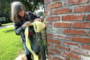 Beaumont resident Julie Wienert wraps her outside pipes in protective insulation after getting supplies at M & D Supply in Beaumont Tuesday as she prepares her home for the freezing temperatures that moved into the area overnight into Wednesday morning. Wienert says the outdoor pipes froze last year during a similar cold snap and wanted to prevent a similar problem during this arctic front. Photo taken Tuesday, November 12, 2019 Kim Brent/The Enterprise
