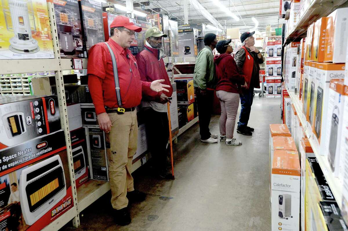 Workers assist shoppers as they look through the shelves filled with space heaters at M & D Supply Tuesday as area residents and businesses prepare for the freezing temperatures that moved into the area overnight into Wednesday morning. Photo taken Tuesday, November 12, 2019 Kim Brent/The Enterprise