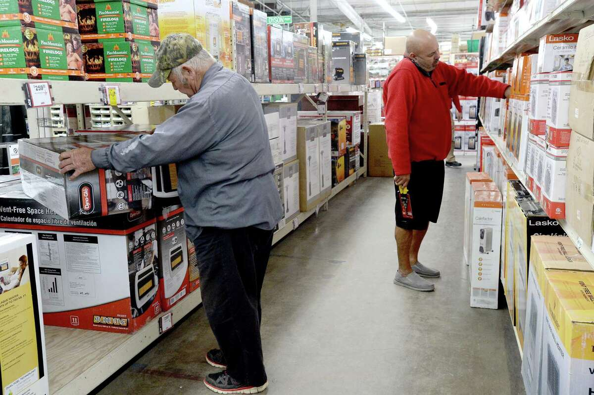 Shoppers look through the shelves filled with space heaters at M & D Supply Tuesday as area residents and businesses prepare for the freezing temperatures that moved into the area overnight into Wednesday morning. Photo taken Tuesday, November 12, 2019 Kim Brent/The Enterprise