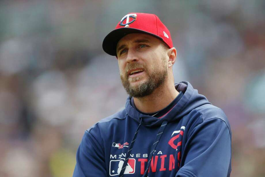 FILE - In this May 11, 2019, file photo, Minnesota Twins manager Rocco Baldelli looks up during the team's baseball game against the Detroit Tigers in Minneapolis. Baldelli has narrowly beaten out Aaron Boone of the New York Yankees to win AL Manager of the Year. (AP Photo/Jim Mone, File) Photo: Jim Mone / Copyright 2019 The Associated Press. All rights reserved