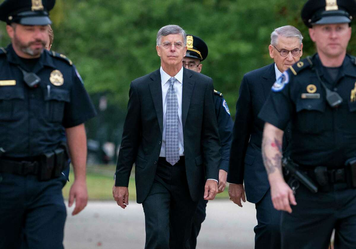 FILe - In this Oct. 22, 2019, file photo Ambassador William Taylor, is escorted by U.S. Capitol Police as he arrives to testify before House committees as part of the Democrats impeachment investigation of President Donald Trump, at the Capitol in Washington. (AP Photo/J. Scott Applewhite, File)