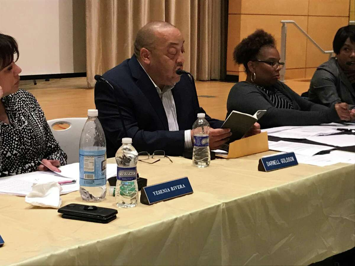 New Haven Board of Education President Darnell Goldson reads through the school board's bylaws during a discussion on a procurement policy on Nov. 12, 2019.