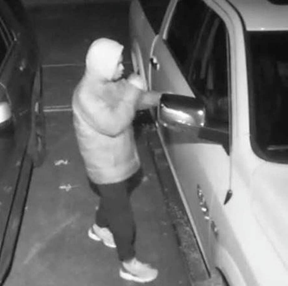 North Haven police are looking to identify this person who was seen checking for unlocked vehicles in town Tuesday, Nov. 12, 2019. Photo: Contributed Photo / North Haven Police Department