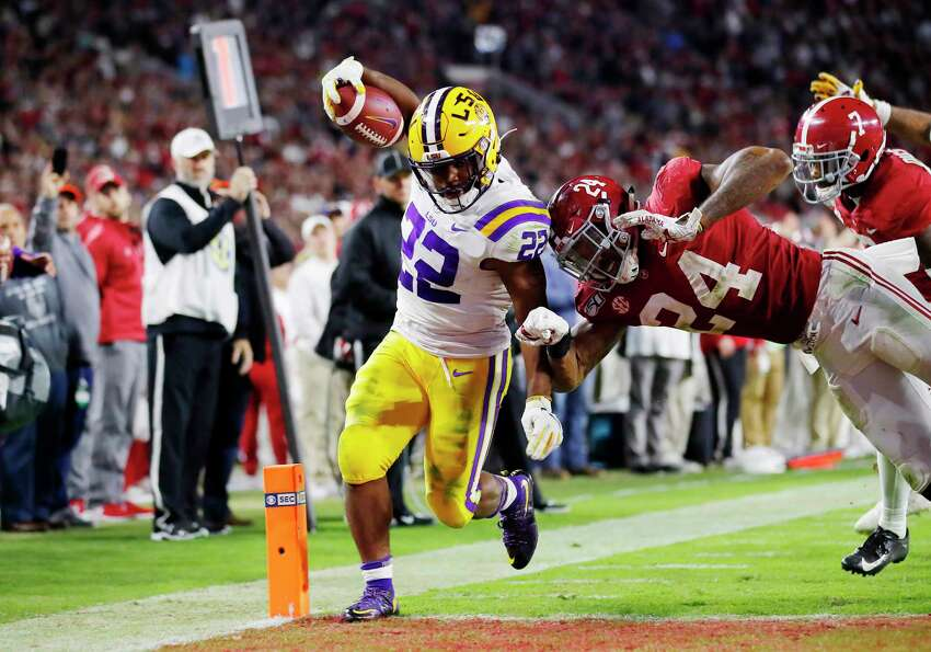 TUSCALOOSA, ALABAMA - NOVEMBER 09: Clyde Edwards-Helaire #22 of the LSU Tigers rushes for a 7-yard touchdown during the fourth quarter against the Alabama Crimson Tide in the game at Bryant-Denny Stadium on November 09, 2019 in Tuscaloosa, Alabama. (Photo by Todd Kirkland/Getty Images) ***BESTPIX***