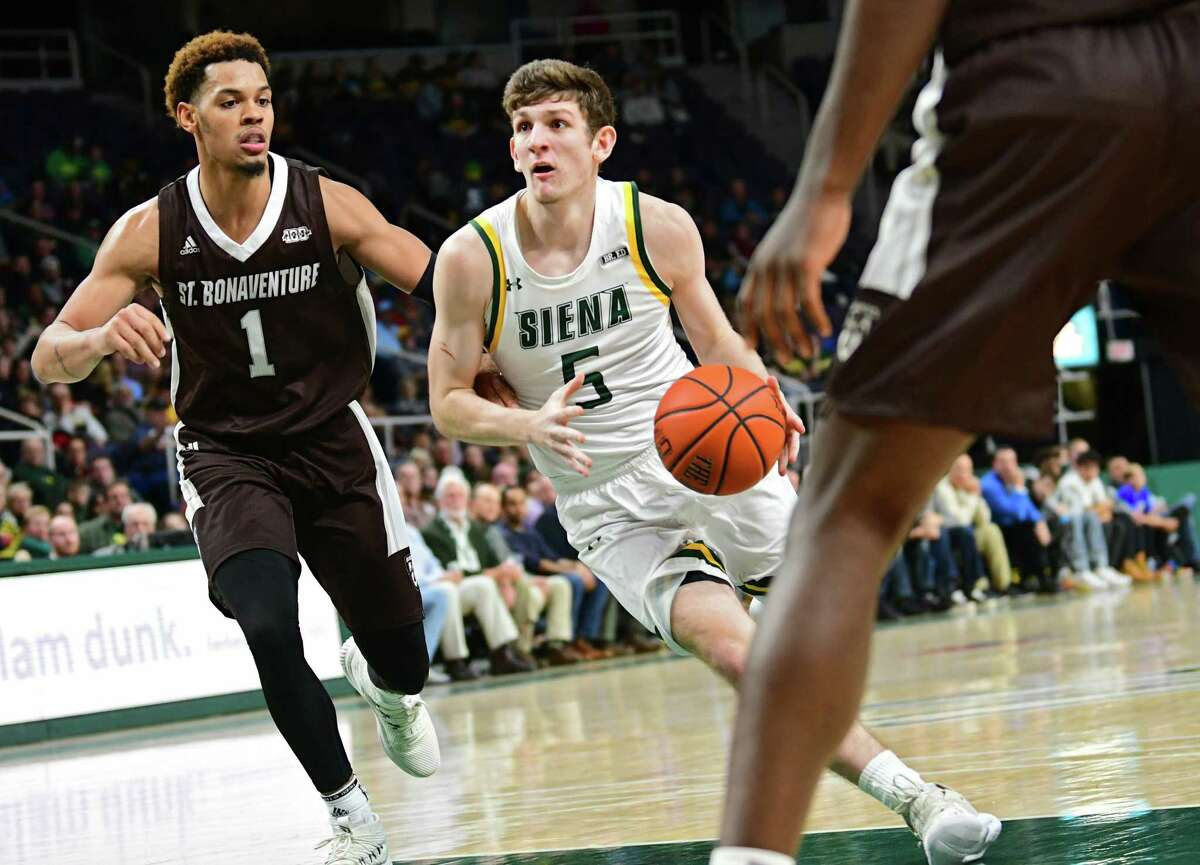 Siena's Matt Hein drives to the hoop defended by St. Bonaventure's Dominick Welch during a basketball game at the Times Union Center on Tuesday, Nov. 12, 2019 in Albany, N.Y. (Lori Van Buren/Times Union)