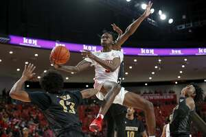 Houston Cougars guard DeJon Jarreau (3) goes up for a shot defended by Alabama State Hornets guard AJ Farrar (13) and guard Tyrese Robinson (35) during first half of the NCAA basketball game between the Houston Cougars and the Alabama State Hornets at the Fertitta Center in Houston, TX on Tuesday, November 12, 2019.