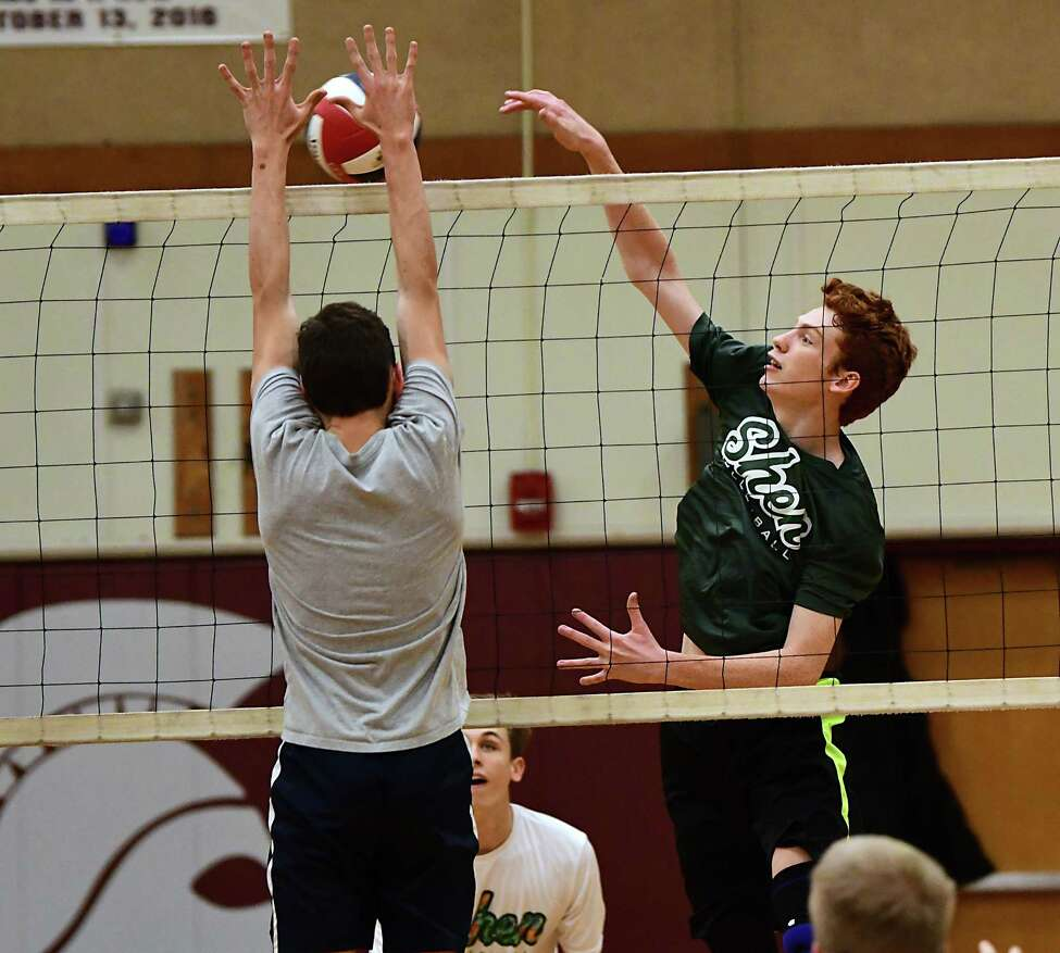 Shenendhowa volleyball player Tyler Christensen, right, returns the ball during a scrimmage against Burnt Hills on Tuesday, Nov. 12, 2019 in Burnt Hills, N.Y. (Lori Van Buren/Times Union)
