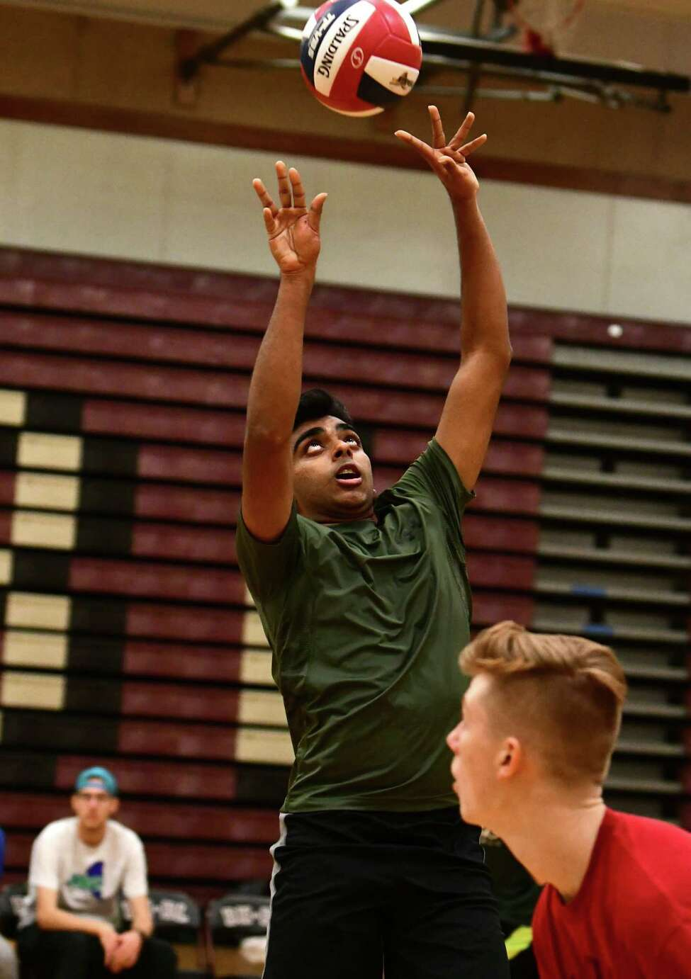Shenendhowa volleyball player Rohan Gangaraju sets the ball during a scrimmage against Burnt Hills on Tuesday, Nov. 12, 2019 in Burnt Hills, N.Y. (Lori Van Buren/Times Union)