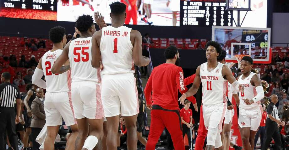 Houston Cougars guard Nate Hinton (11) celebrates with teammates during a timeout during second half of the NCAA basketball game between the Houston Cougars and the Alabama State Hornets at the Fertitta Center in Houston, TX on Tuesday, November 12, 2019. Photo: Tim Warner/Contributor
