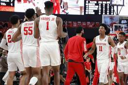 Houston Cougars guard Nate Hinton (11) celebrates with teammates during a timeout during second half of the NCAA basketball game between the Houston Cougars and the Alabama State Hornets at the Fertitta Center in Houston, TX on Tuesday, November 12, 2019.