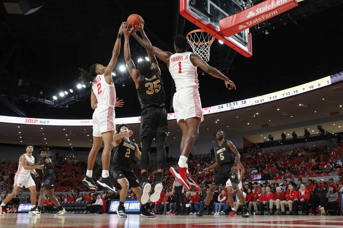 Houston Cougars center Chris Harris Jr. (1) and guard Caleb Mills (2) battle with Alabama State Hornets guard Tyrese Robinson (35) for a rebound during second half of the NCAA basketball game between the Houston Cougars and the Alabama State Hornets at the Fertitta Center in Houston, TX on Tuesday, November 12, 2019.