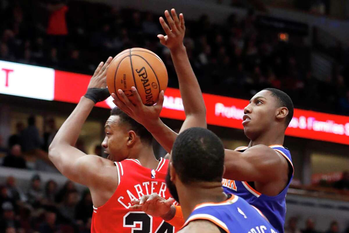New York Knicks' RJ Barrett, right, shoots past Chicago Bulls' Wendell Carter Jr. during the first half of an NBA basketball game Tuesday, Nov. 12, 2019, in Chicago. (AP Photo/Charles Rex Arbogast)
