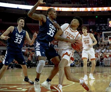 UT's Gerald Liddell, a former Steele standout, drives on California Baptist's De'Jon Davis for two of his nine points Tuesday at the Erwin Center.
