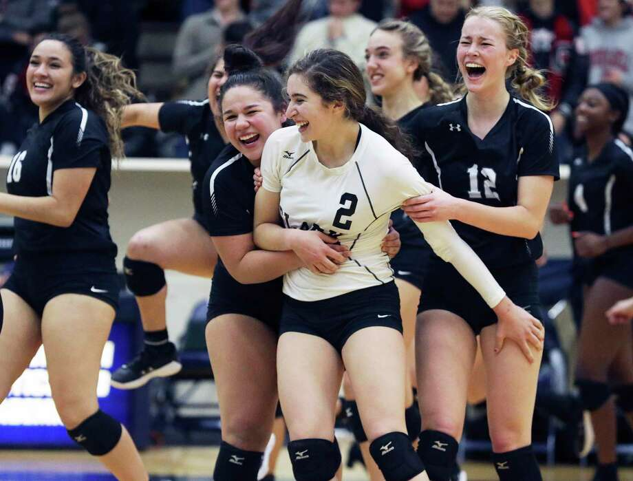 Clark's Madison Cuellar (2) celebrates with teammates after their win over Churchill in Class 6A third-round volleyball playoff action at the Alamo Convocation Center on Nov. 12, 2019. Photo: Tom Reel /Staff Photographer / 2019 SAN ANTONIO EXPRESS-NEWS