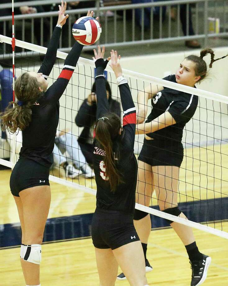 Clark hitter Mackenzie Wolff gets the ball over defenders as Clark plays Churchill in 6A third round volleyball playoff action at the Alamo Convocation Center on Nov. 12, 2019. Photo: Tom Reel, Staff / Staff Photographer / 2019 SAN ANTONIO EXPRESS-NEWS
