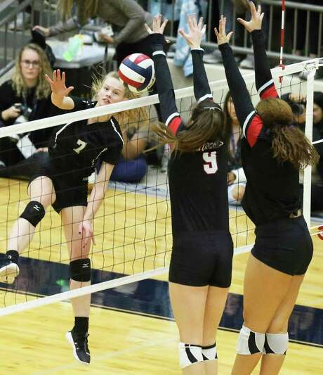 Clark hitter Shadee Briggs gets the ball over defenders as Clark plays Churchill in 6A third round volleyball playoff action at the Alamo Convocation Center on Nov. 12, 2019. Photo: Tom Reel, Staff / Staff Photographer / 2019 SAN ANTONIO EXPRESS-NEWS