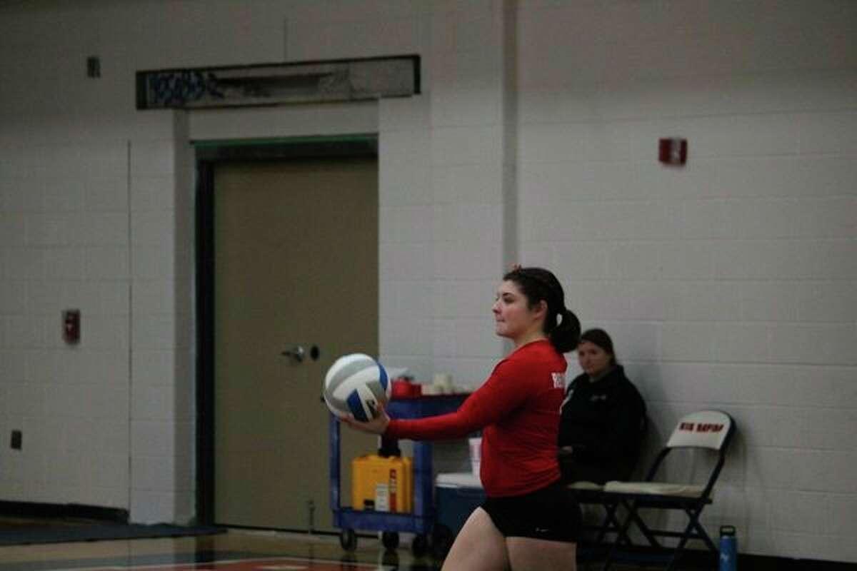 Maddie Morgan gets ready to make a serve in district action last week. (Pioneer photo/John Raffel)