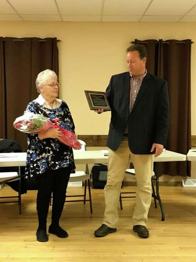 Evart Township Supervisor Doug Derscheid presented Trustee Sarah Parsons with a Civic Award in appreciation of her 51 years of service to the township at a meeting on Thursday, Nov. 7. (Submitted photo)