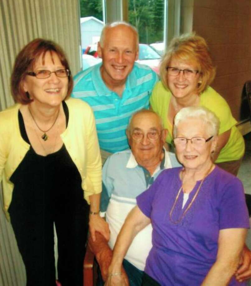 This is the Fillmore family. In back, from left, are Carolyn Bruce, and Lori. In the front are Courtney and his wife of 65 years, Marilyn (Henry).