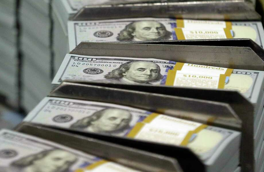 FILE - In this Sept. 24, 2013, file photo, freshly-cut stacks of $100 bills make their way down the line at the Bureau of Engraving and Printing Western Currency Facility in Fort Worth, Texas. Borrowing money from family can create an awkward situation. Setting up a loan agreement can make it easier to avoid hurt feelings and disputes down the road. (AP Photo/LM Otero, File) Photo: LM Otero / Associated Press / Copyright 2016 The Associated Press. All rights reserved.