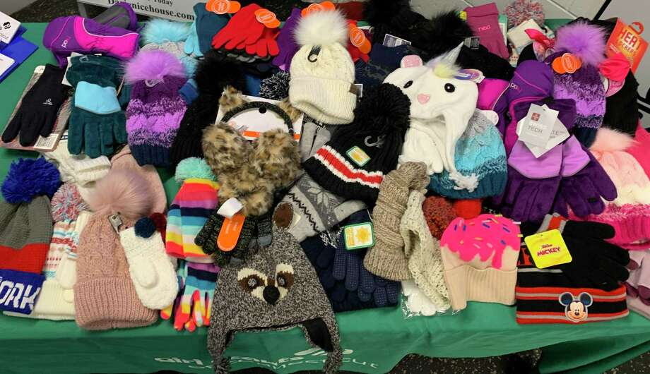 Warm mittens and hats were the entry fee at a recent Darien Girl Scout event at Darien Ice Rink Photo: Darien Girl Scouts /