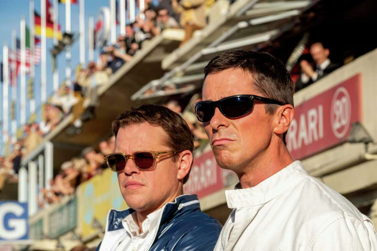 """This image released by 20th Century fox shows Christian Bale, right, and Matt Damon in a scene from """"Ford v. Ferrari,"""" in theaters on Nov. 15. (Merrick Morton/20th Century Fox via AP)"""