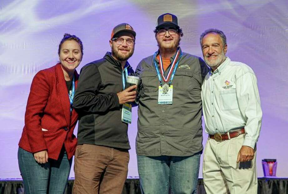 From left, Theresa Wasinski, Evan Westervelt, Kyle Sanborn and Charlie Papazian of the Great American Beer Festival pose for a photo together during the Great American Beer Festival in Denver. (Photo provided)