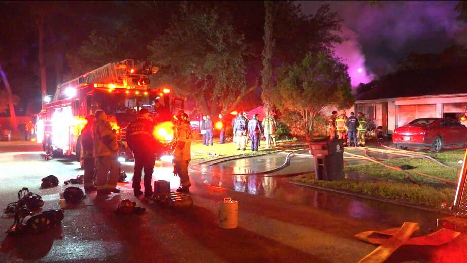 Houston firefighters work on a house fire in the12200 block of Blue River Drive on Wednesday, Nov. 13, 2019. Photo: OnScene.TV